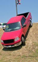 Hvordan legge tunge ting i en pickup lastebil