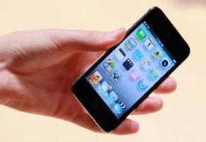 Hvordan kan jeg vite om My Apple iPod touch er ferdig med å lade?
